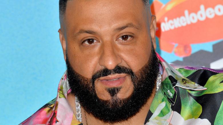 DJ Khaled, 2019 Nickelodeon red carpet, colorful flow shirt, facial hair, not smiling
