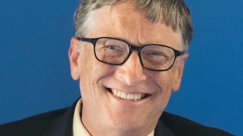 Bill Gates smiling wearing glasses
