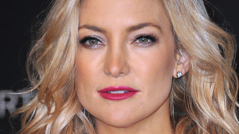Kate Hudson poses at an event