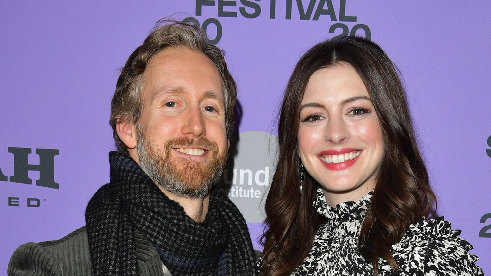 Adam Shulman and Anne Hathaway attend an event