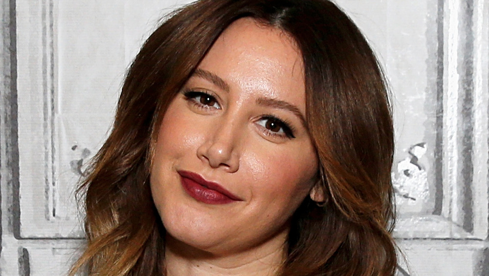 Ashley Tisdale wears an animal-print dress at an event