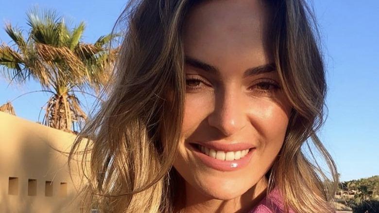 Katie Flood, selfie, smiling, brown hair down, 2021 photo in Mexico