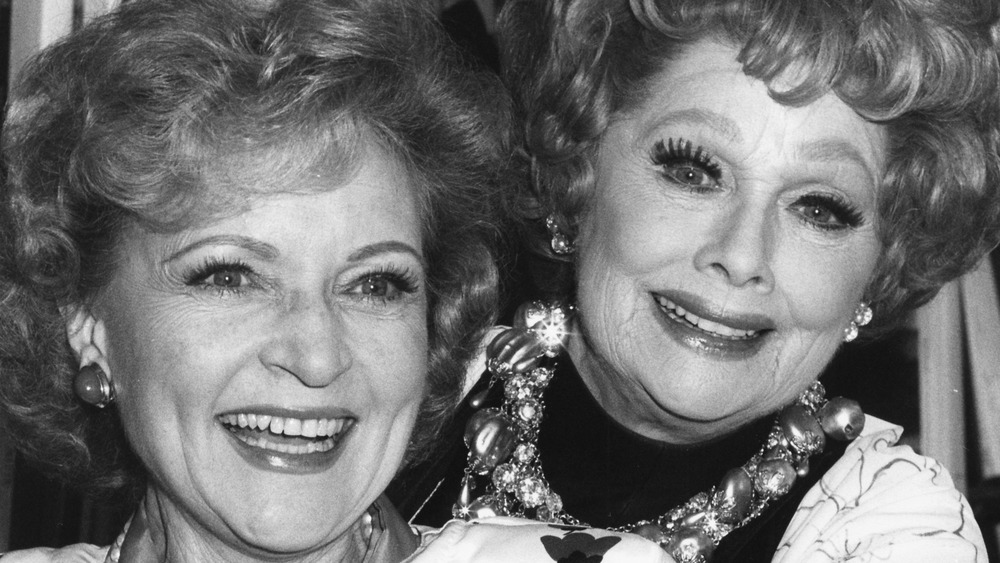 Betty White and Lucille Ball smiling