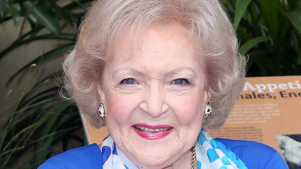 Betty White poses at an event