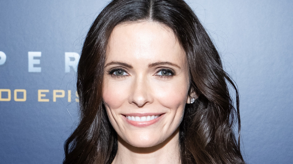 Bitsie Tulloch smiling on the red carpet