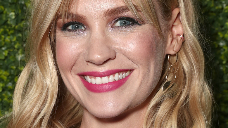 January Jones smiles wearing pink lipstick
