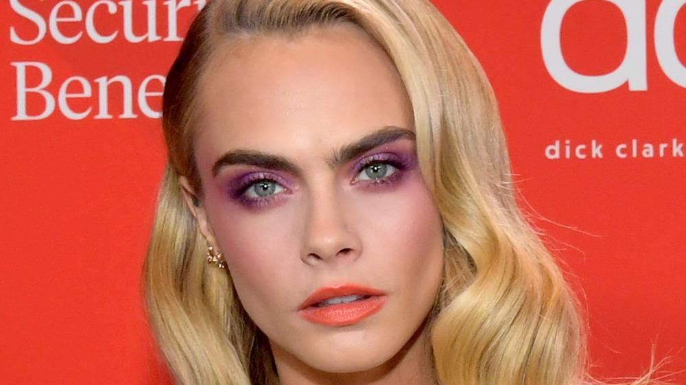 Cara Delevingne wearing violet eyeshadow