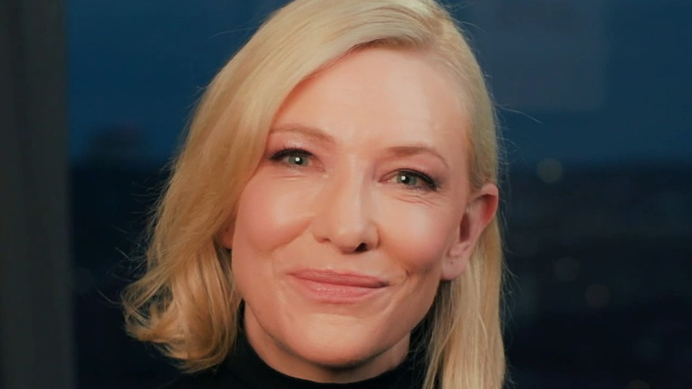 Cate Blanchett smiles while sitting down for an interview