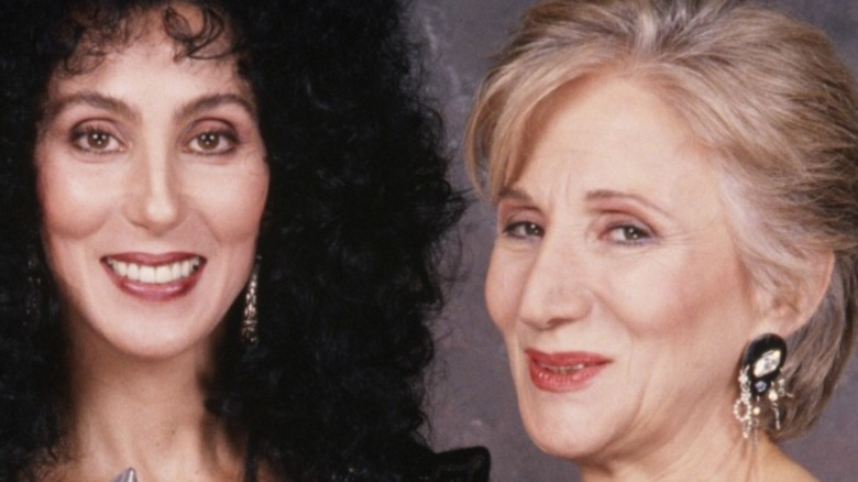 Cher, poses with her People's Choice Award and presenter Olympia Dukakis in 1989