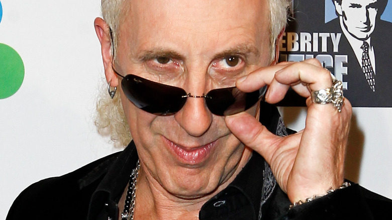 Dee Snider posing at a red carpet event