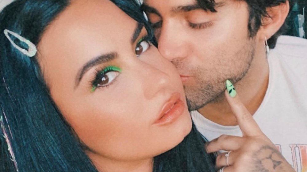 Demi Lovato getting a kiss from Max Ehrich in an Instagram selfie
