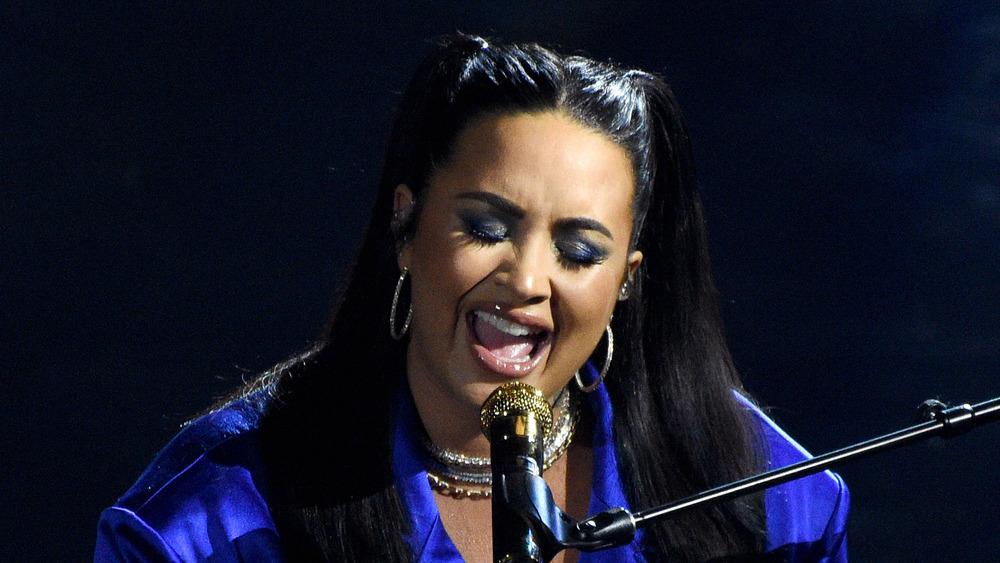 Demi Lovato singing into a microphone