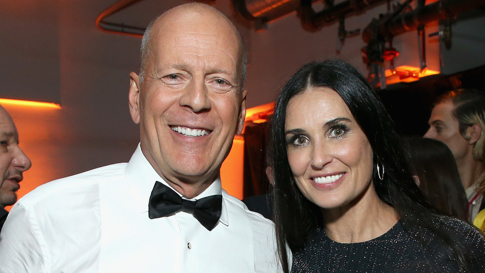 Bruce Willis and Demi Moore smiling