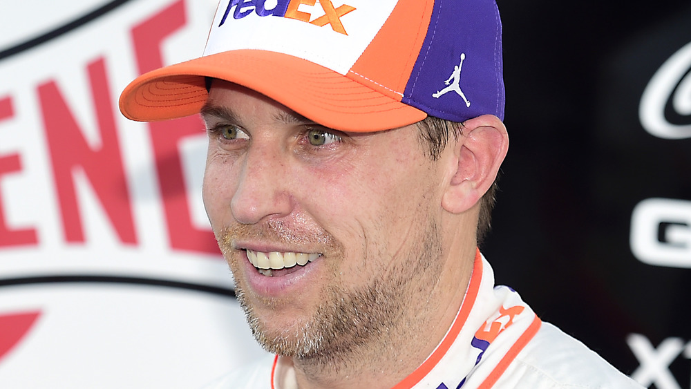 Denny Hamlin speaking to reporters after a race