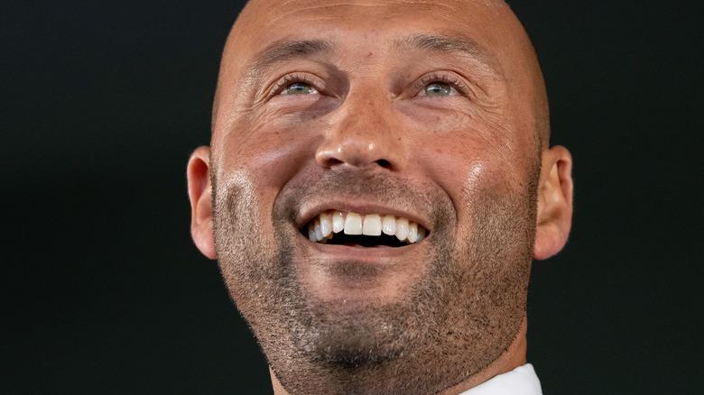 Derek Jeter laughing in suit