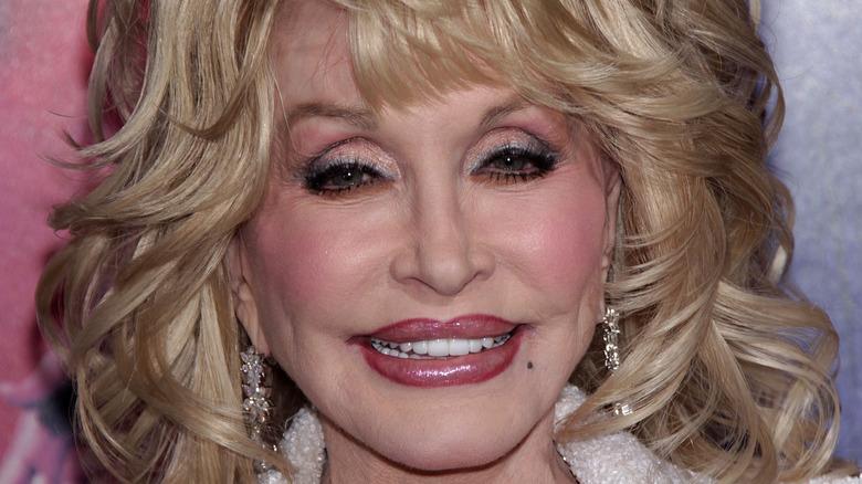 Dolly Parton smiling and looking at camera