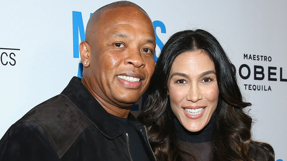 Dr. Dre and Nicole Young smiling