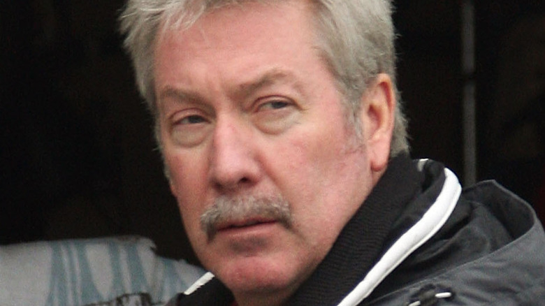 Drew Peterson in front of garbage can in 2007.
