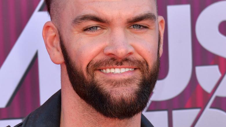 Dylan Scott smiles on the red carpet