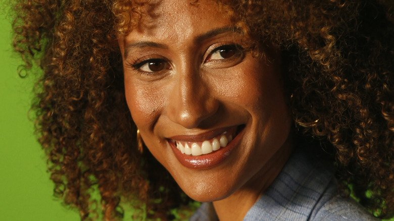 Elaine Welteroth smiling and looking to the side