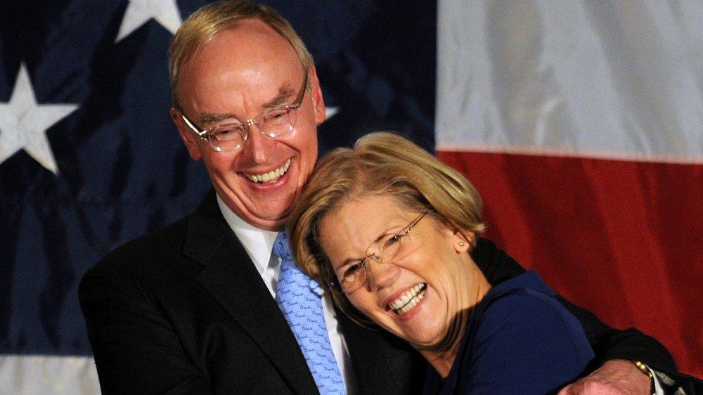 Elizabeth Warren waves to the crowd after her acceptance speech after beating incumbent U.S. Senator Scott Bown