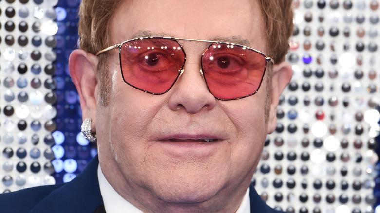 Elton John smiles at a photo call