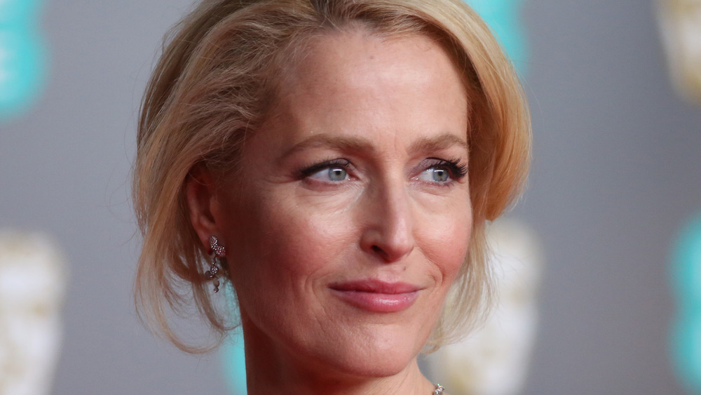 Gillian Anderson with a blonde updo at a premiere