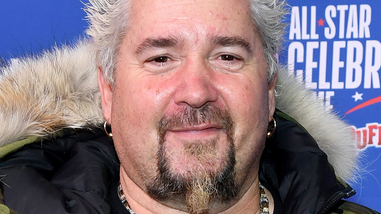 Guy Fieri at a basketball game