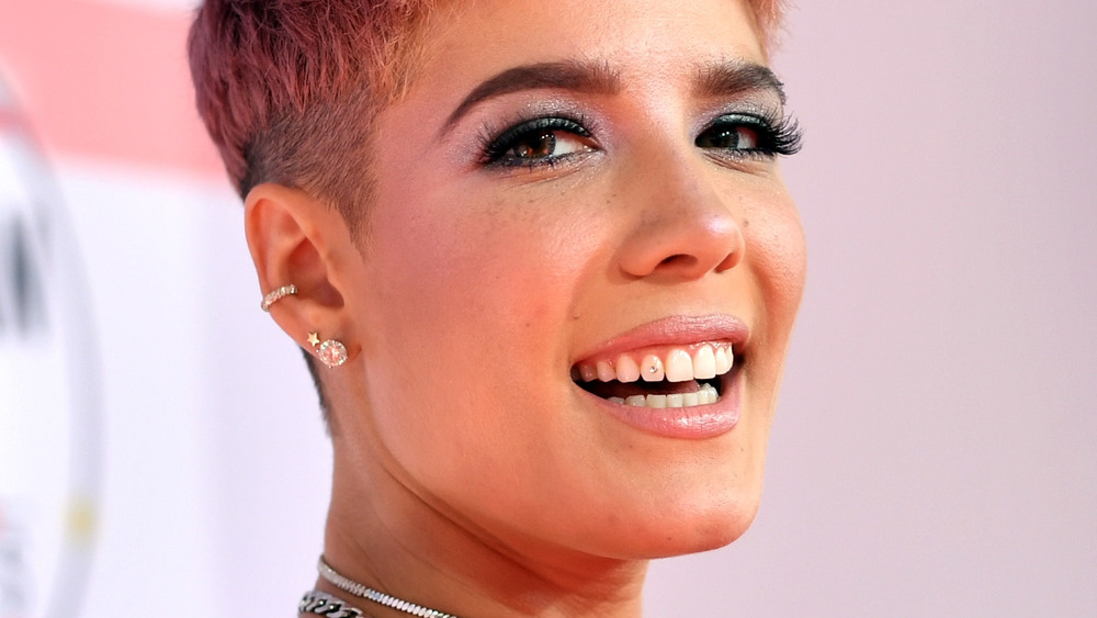 Halsey smiling with a jewel on her tooth