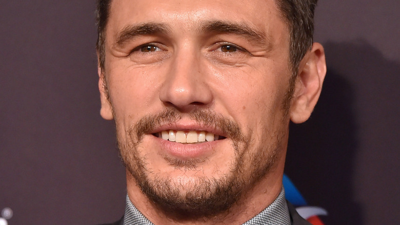 James Franco slightly smiling and looking to side on red carpet