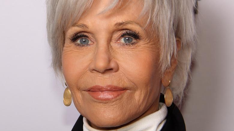 Jane Fonda smiles in short silver hair.