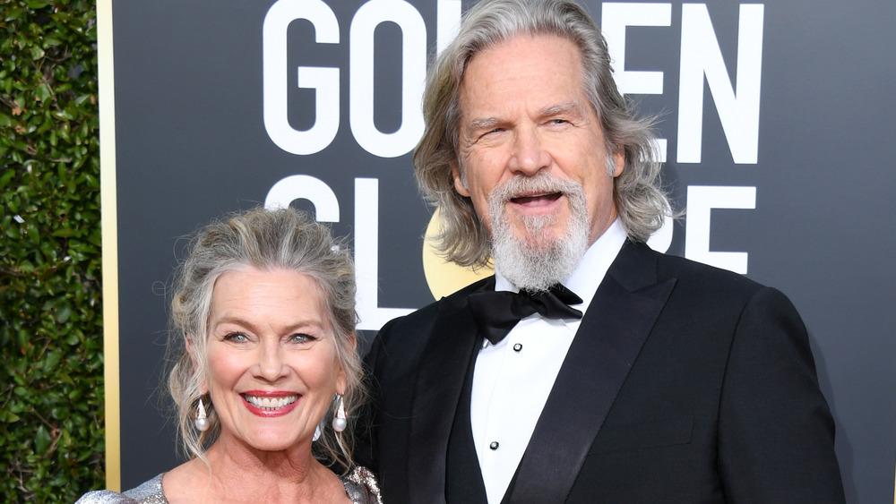 Jeff Bridges and Susan Geston smiling on the red carpet