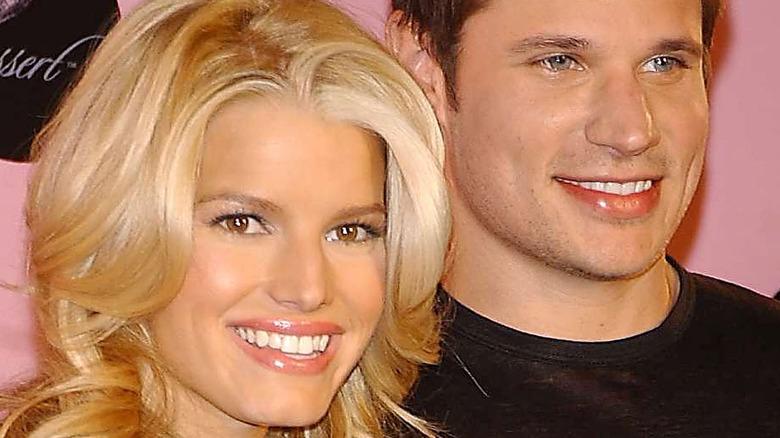 Jessica Simpson and Nick Lachey smile