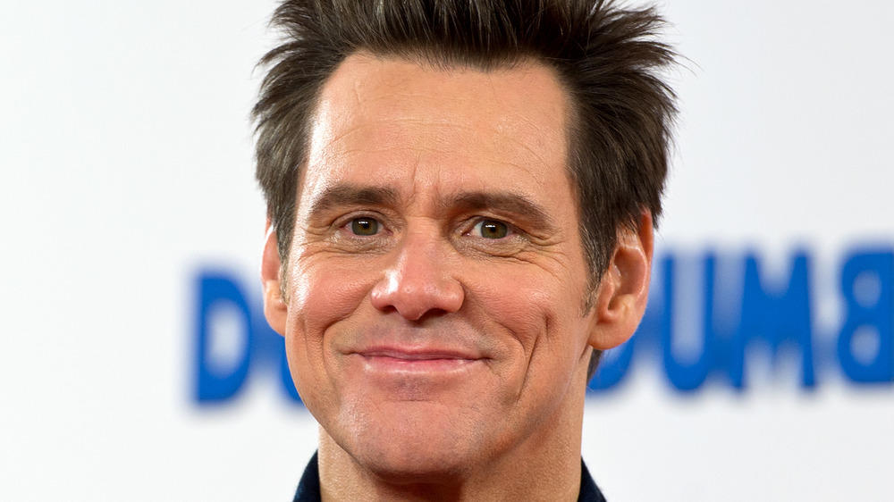 Jim Carrey smiles on the red carpet for Dumber and Dumber To in 2014