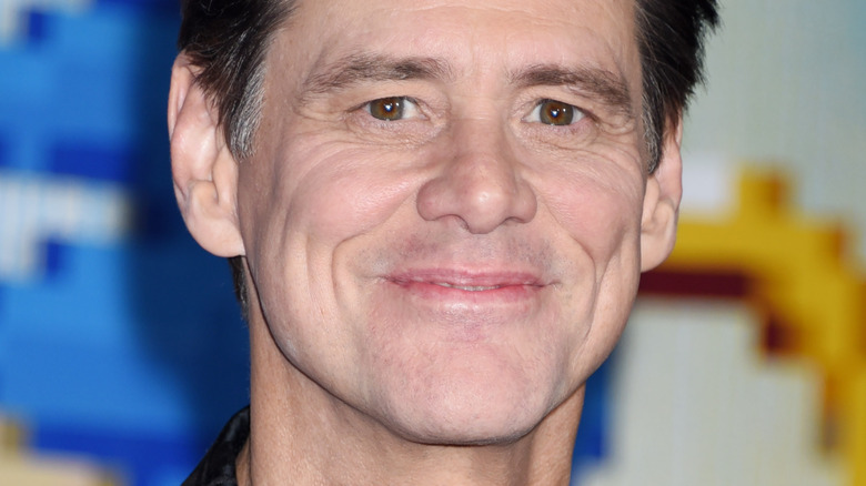 Jim Carrey smiles on the red carpet