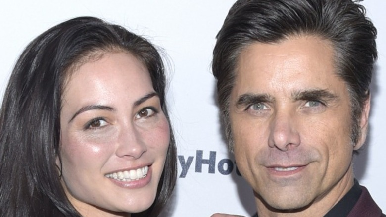 Caitlin McHugh and John Stamos attend Bob Saget's Cool Comedy Hot Cuisine in 2019