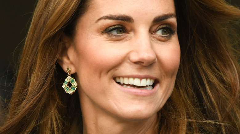 Kate Middleton smiling at event