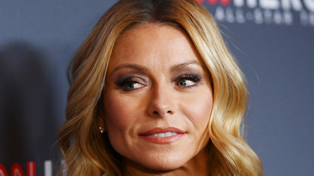 Kelly Ripa staring off to the side