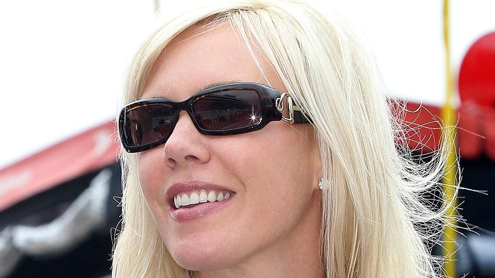 DeLana Harvick posing in sunglasses