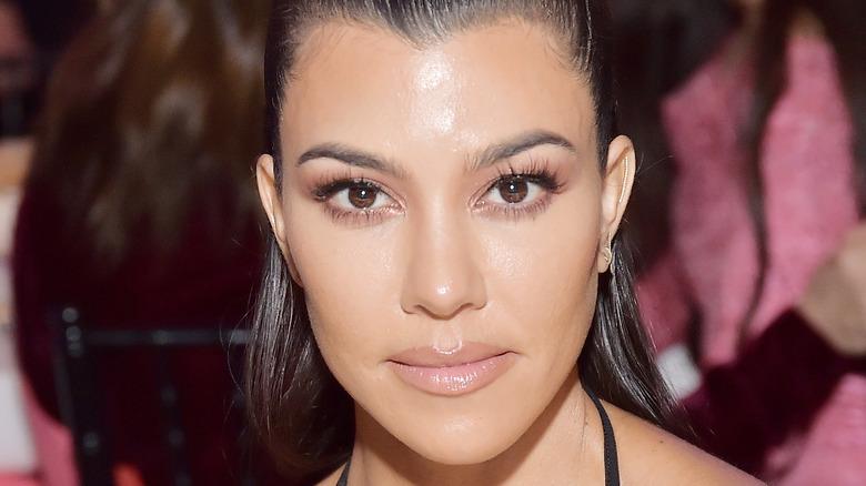 Kourtney Kardashian looking at camera