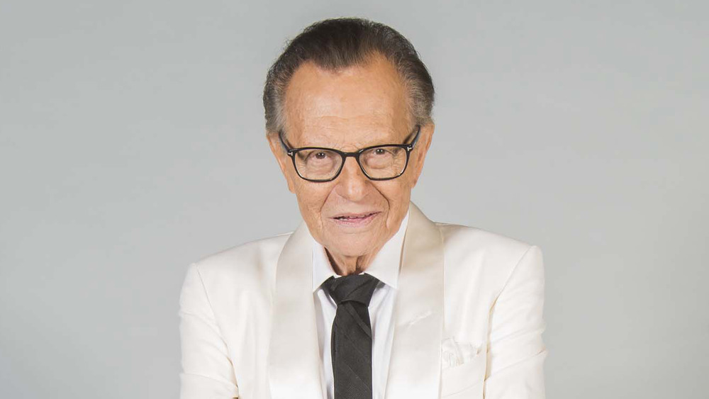 Larry King posing for a portrait
