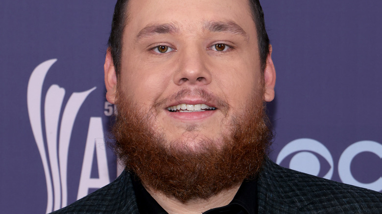 Luke Combs smiling on the red carpet
