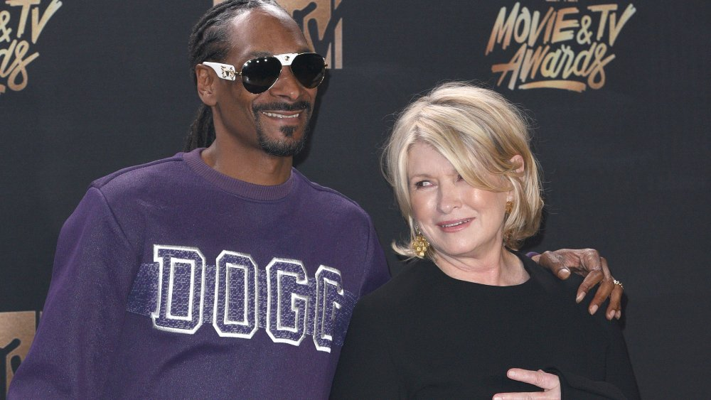 Snoop Dogg and Martha Stewart smiling and posing together on the red carpet