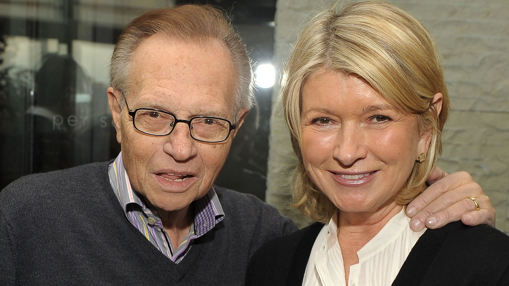 Larry King and Martha Stewart posing together