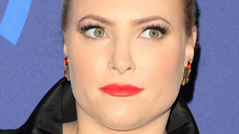 Meghan McCain looking to the side with slight smile on the red carpet