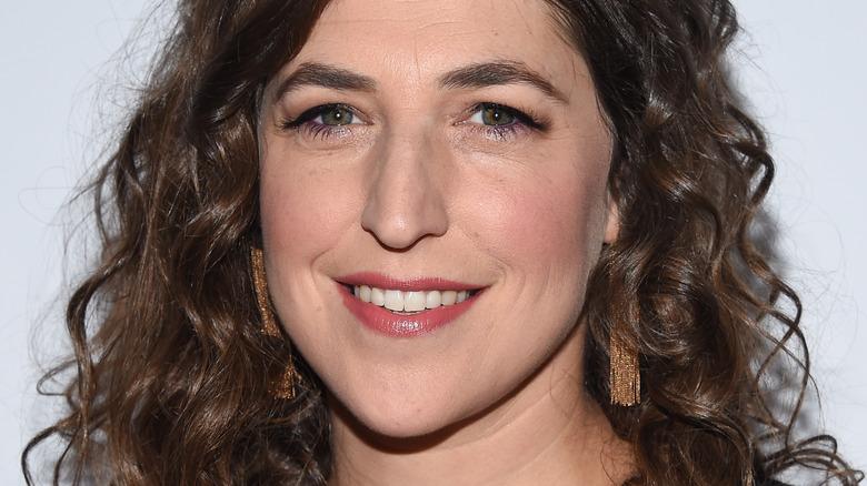 Mayim Bialik smiles on red carpet