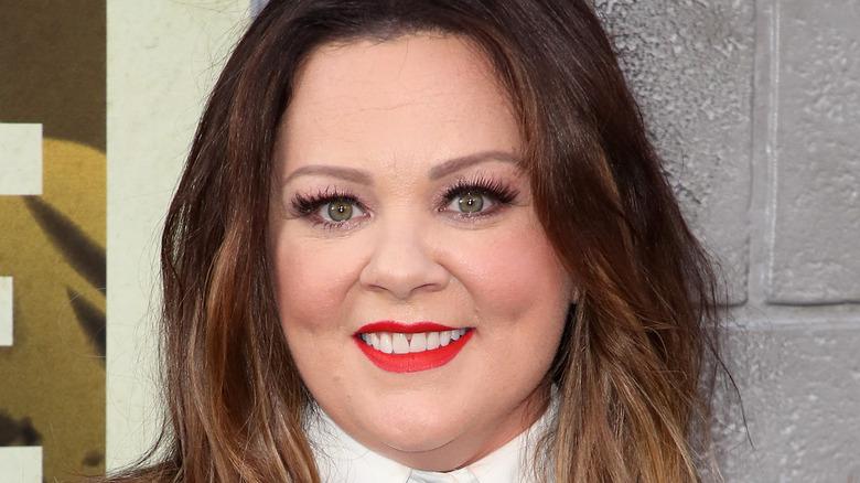 Melissa McCarthy wearing red lipstick at The Kitchen premiere