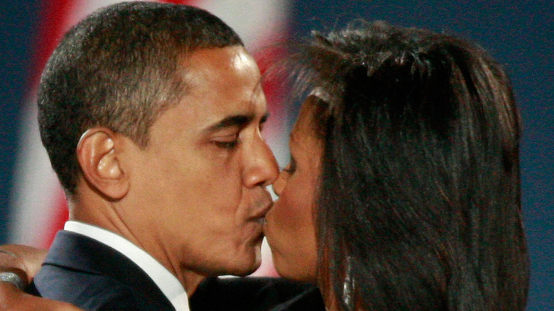 Michelle and Barack Obama kissing