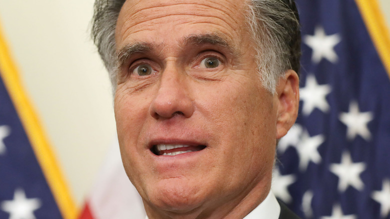 Sen. Mitt Romney (R-UT) in front of flag during news conference at the U.S. Capitol 2019