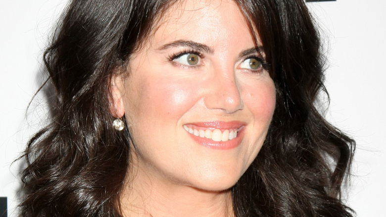 Monica Lewinsky smiling and looking to the side